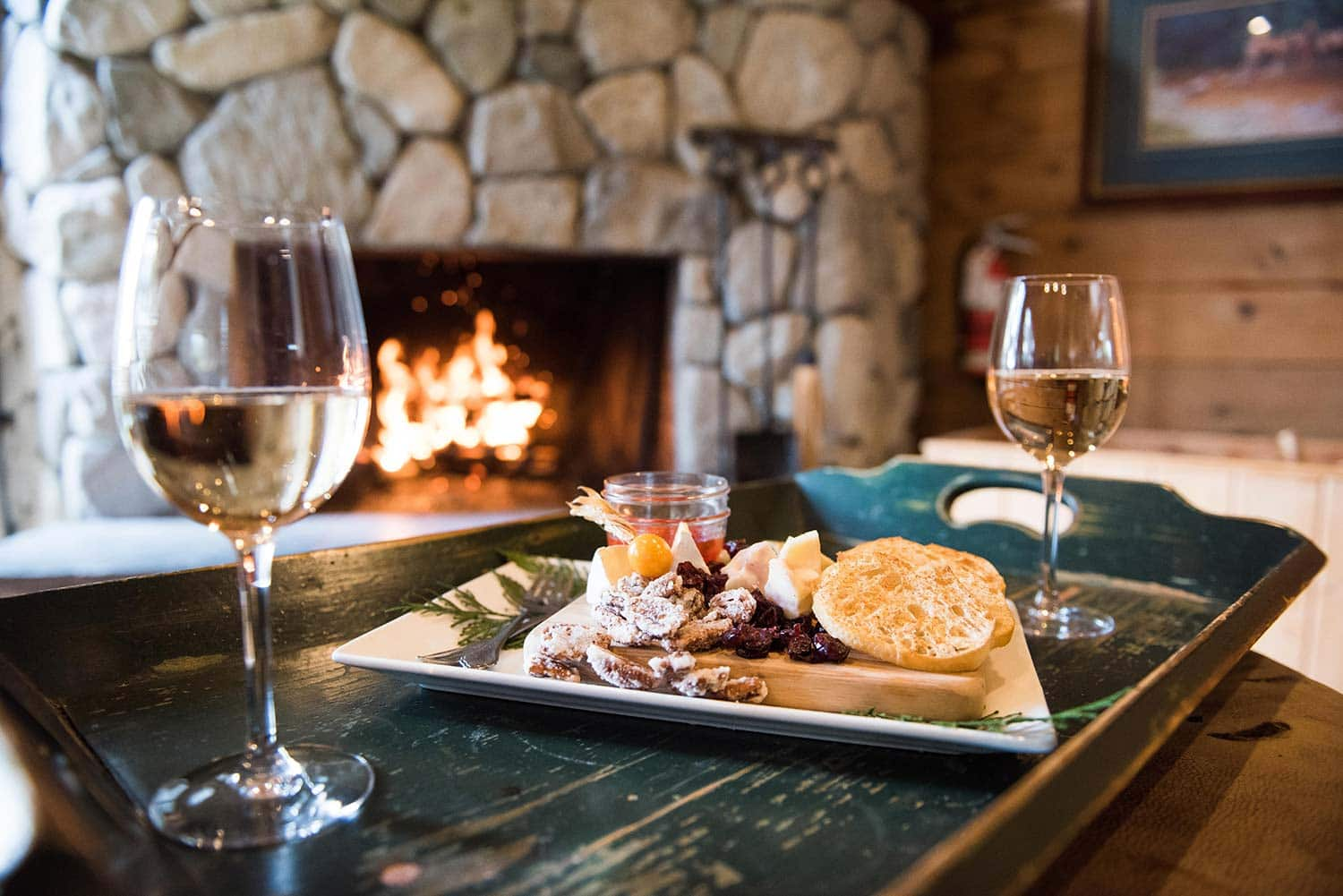 Cozy up at the fireplace at Rowena's Inn